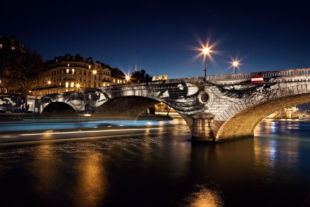 28 Millim+¿tres, Women Are Heroes, Exhibition in Paris, Pont Louis-Philippe - Pont Marie side by night, with barge, France, 2010
